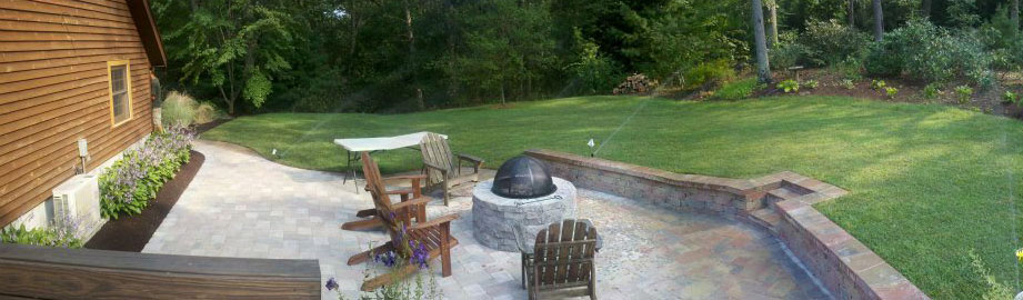 Backyard patio, firepit and retaining wall